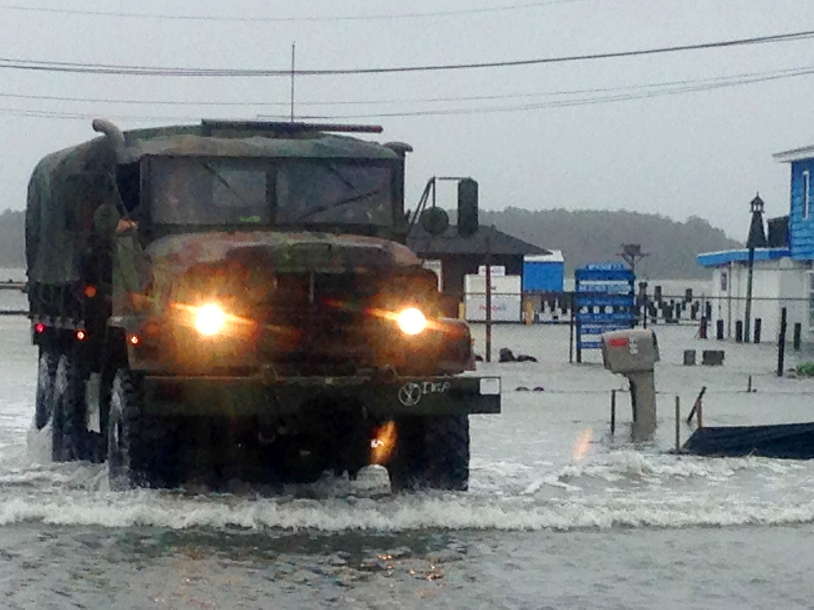 Police patrol flooded streets in a military vehicle in Dewey Beach, Del., on Saturday, Oct. 3, 2015. Tidal flooding from a nor'easter continues to make driving a challenge in the storm-battered resort town of Ocean City, Maryland. Police closed State Route 1, a major artery crossing Indian River Inlet, between the resort towns of Bethany Beach and Dewey Beach. A coastal flood warning and limited state of emergency remain in effect for Sussex County. (AP Photo/Randall Chase)