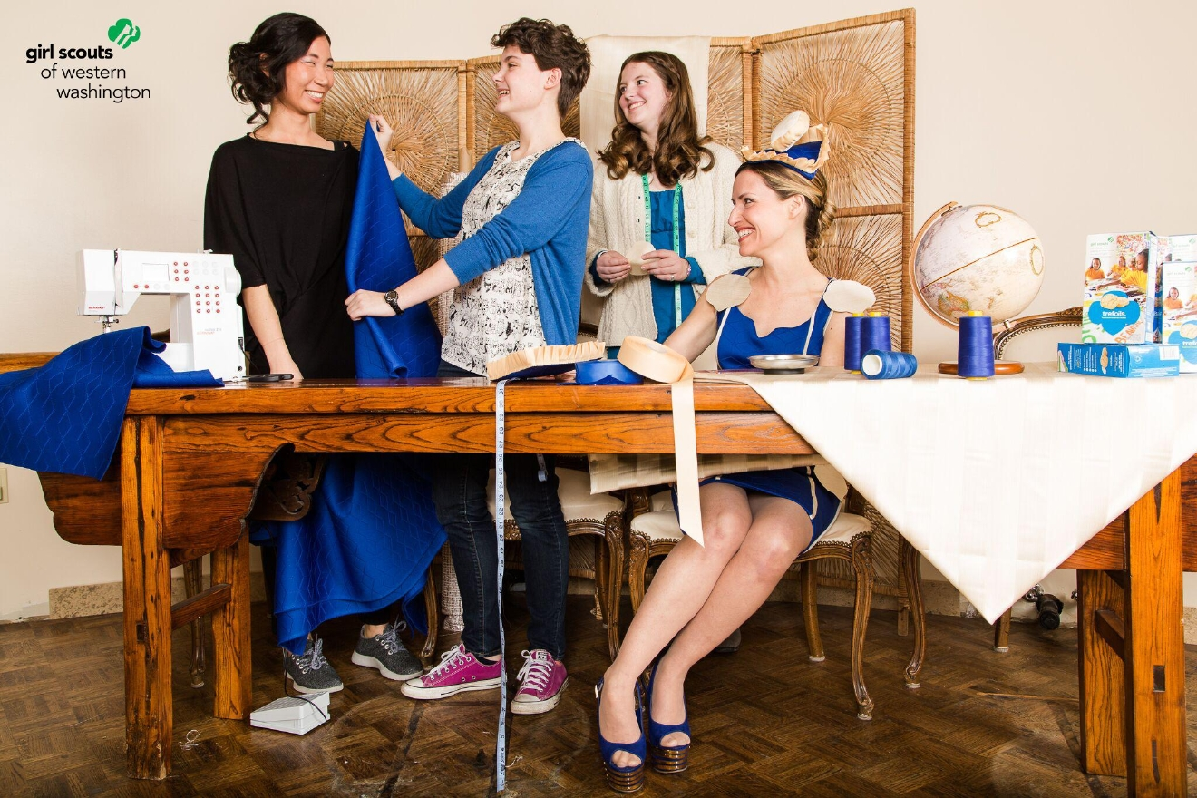 Modeled by Muses co-founder, Sandrine Espie, the Trefoils dress visualizes the connective thread holding the four women pictured together. Joining Espie is Esther Hong, co-founder of Muses along with Girl Scouts Julia Witecki and Carleigh Templin. Thread, fabric and other sewing materials are at the core of their work which supports immigrants, refugees and those in developing nations.  Photo Credit: David Jaewon Oh