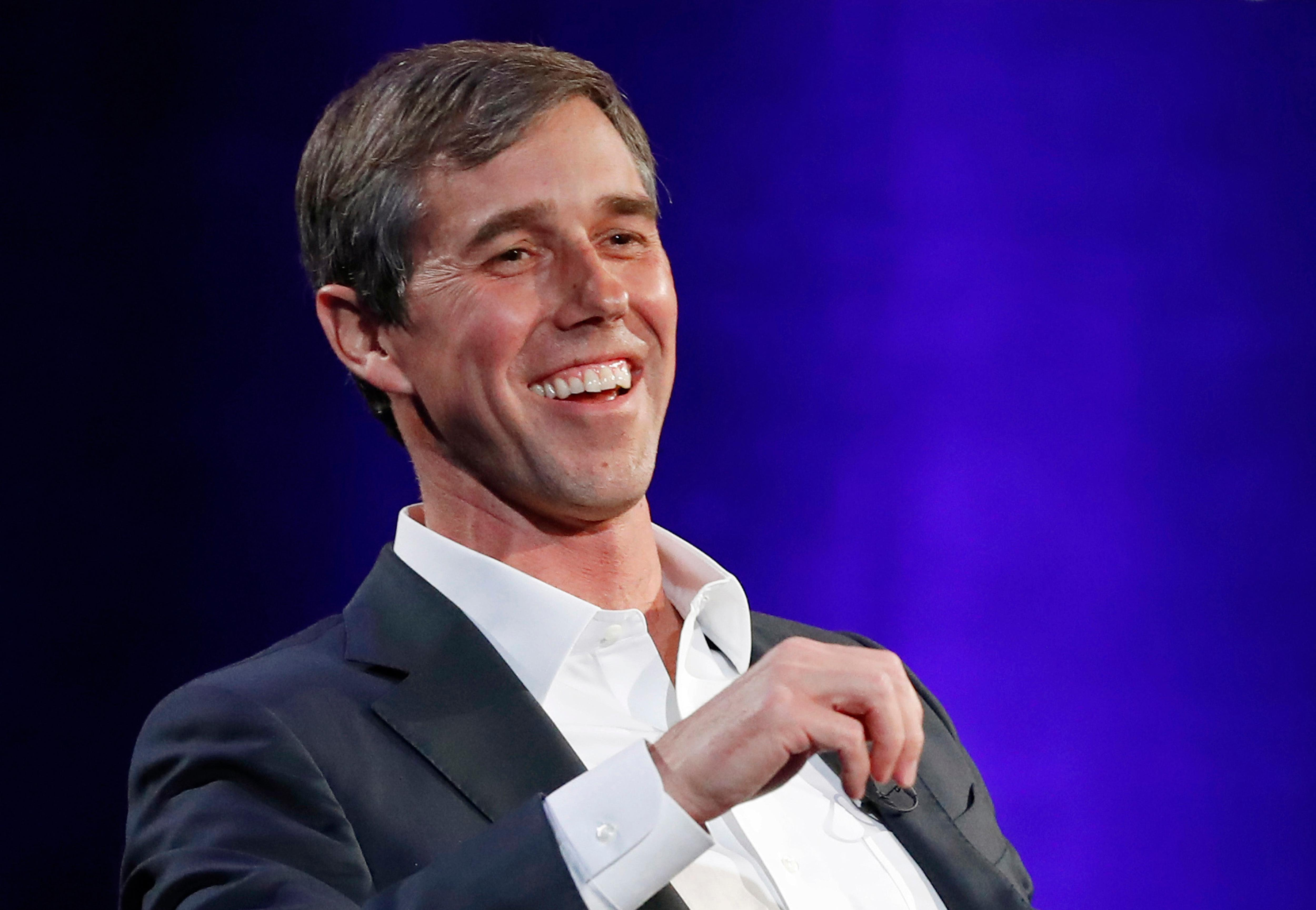 "FILE - In this Tuesday, Feb. 5, 2019 file photo, former Democratic Texas congressman Beto O'Rourke laughs during a live interview with Oprah Winfrey on a Times Square stage at ""SuperSoul Conversations,"" in New York.{ } (AP Photo/Kathy Willens, File)"