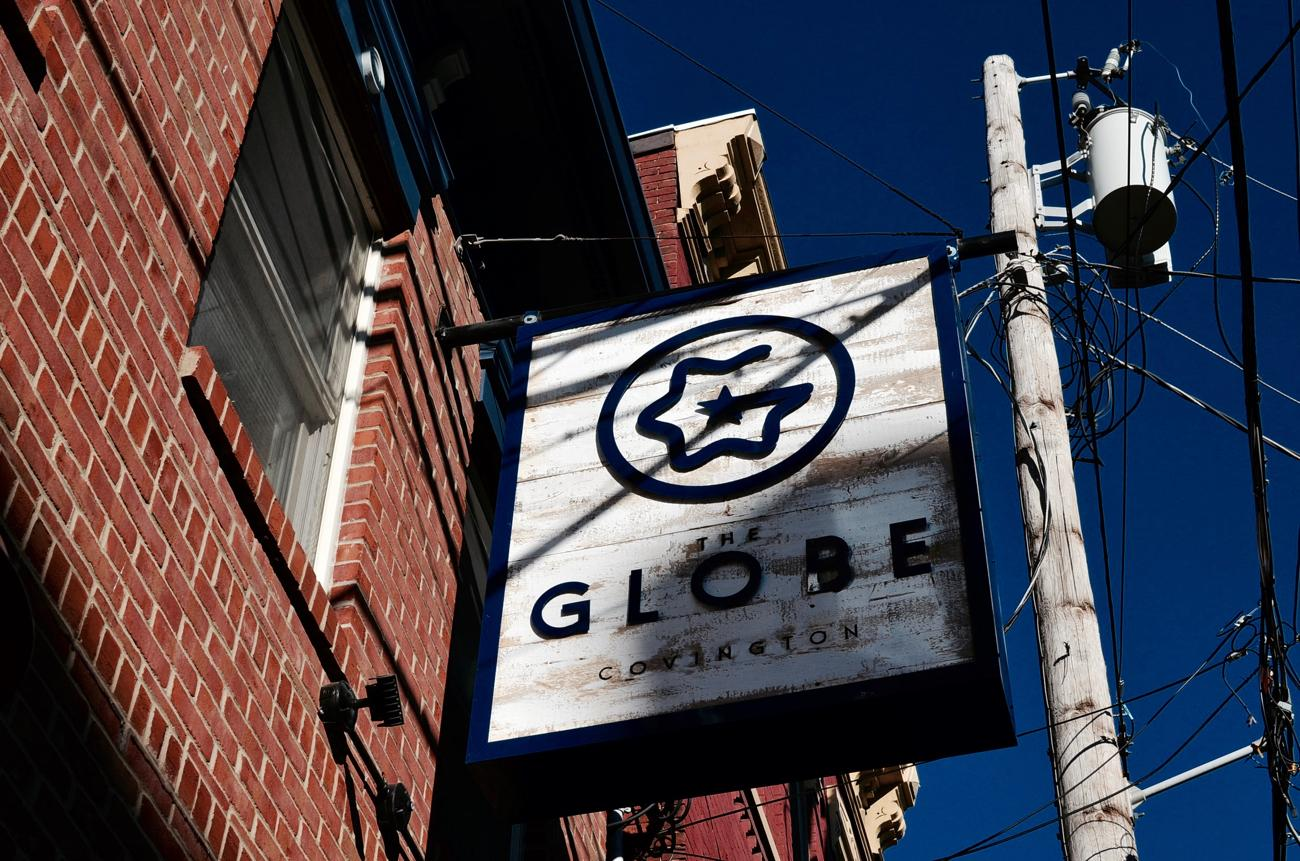 "The Globe is a new neighborhood bar in Covington, housed in the former ""gentlemen's club,"" Club Venus. Tony and Amy Milburn opened the cocktail lounge in Fall 2016. It's named after Tony's great, great-grandfather's boat. Along with a wide array of drink options, The Globe also offers a minimal food menu. ADDRESS: 12 E. 5th Street (41011) / Image: Leah Zipperstein, Cincinnati Refined / Published: 2.23.17"
