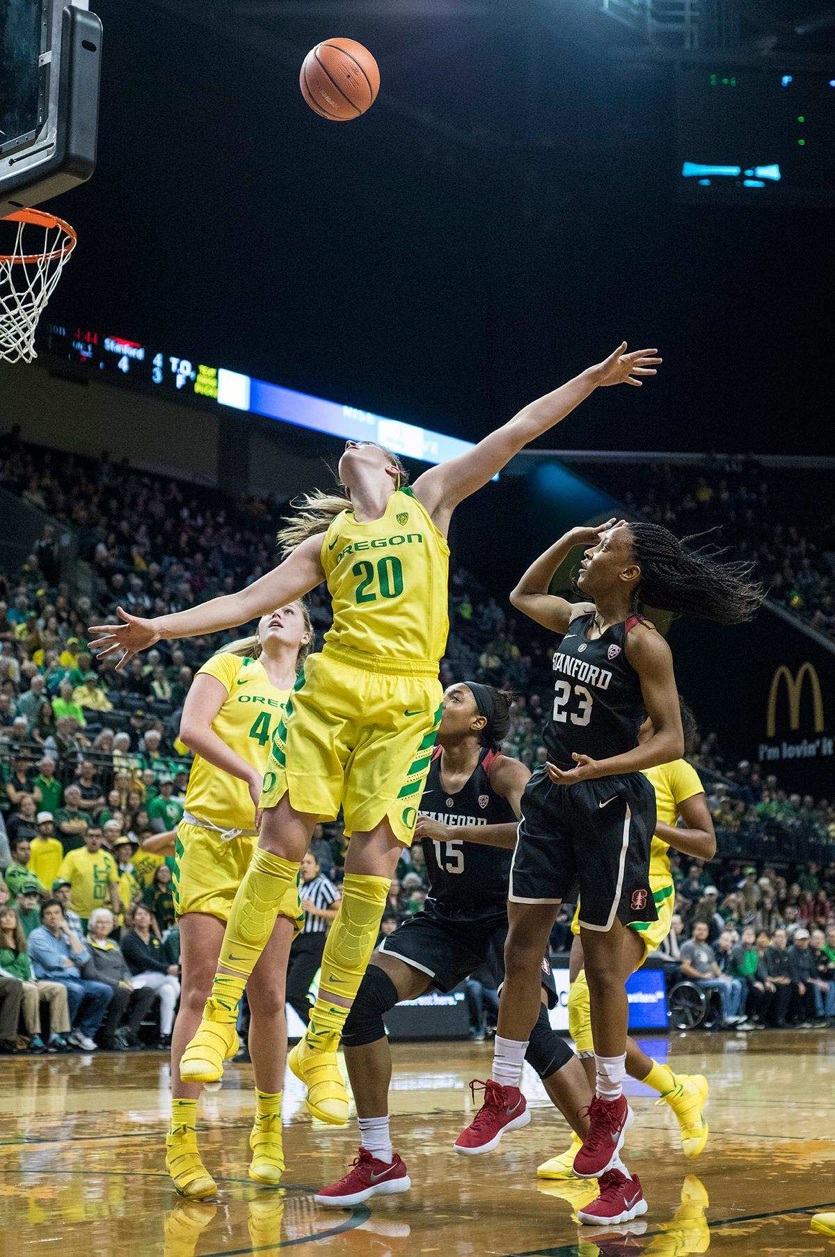 Oregon Ducks Sabrina Ionescu (#20) attempts to block a shot. The Stanford Cardinal defeated the Oregon Ducks 78-65 on Sunday afternoon at Matthew Knight Arena. Stanford is now 10-2 in conference play and with this loss the Ducks drop to 10-2. Leading the Stanford Cardinal was Brittany McPhee with 33 points, Alanna Smith with 14 points, and Kiana Williams with 14 points. For the Ducks Sabrina Ionescu led with 22 points, Ruthy Hebard added 16 points, and Satou Sabally put in 14 points. Photo by Rhianna Gelhart, Oregon News Lab