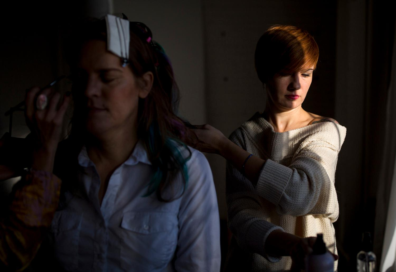 Hair stylist Julia Durfee works on Monika Hawkinson's hair as she receives her first professional makeup session at Sorella Photos studio loft in SODO. Hawkinson has been transitioning from male to female for the past three years. (Sy Bean / Seattle Refined)