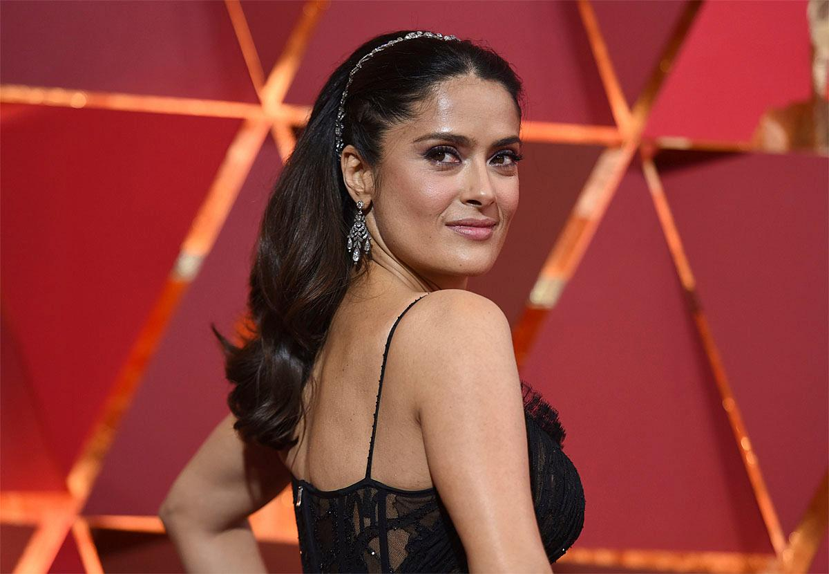 Salma Hayek arrives at the Oscars on Sunday, Feb. 26, 2017, at the Dolby Theatre in Los Angeles. (Photo by Richard Shotwell/Invision/AP)