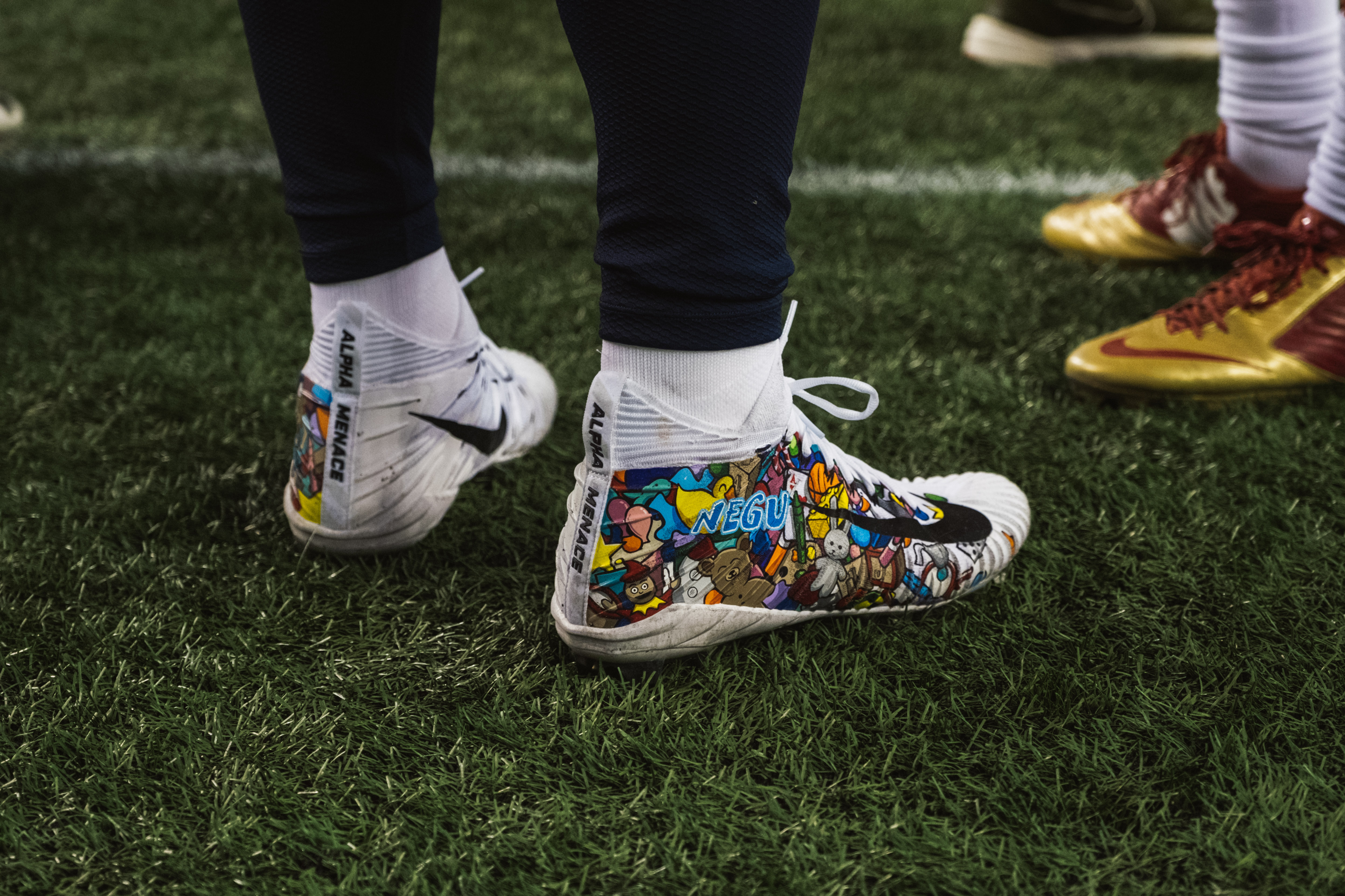 Every year the NFL gives players a chance to showcase a charity of their choice on their shoes with the My Cause, My Cleats game. For tight end Nick Vannett the choice was an easy one. Never Ever Give Up: The Jessie Rees Foundation for Childhood Cancer (NEGU). (Image: Ryan McBoyle / Seattle Refined)
