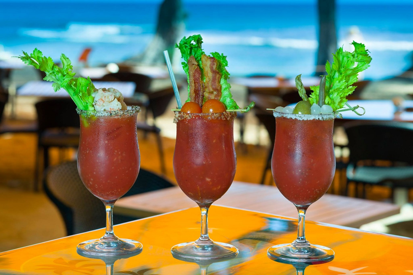 When you picture a Hawaiian vacation, you probably dream of a giant Mai Tai in a cup for two, with your toes in the sand, the sun warming your face, and waves crashing in the background. Well, that's EXACTLY what you're going to get at Lava Lava Beach Club. (Image Courtesy: Lava Lava Beach Club Facebook Page)