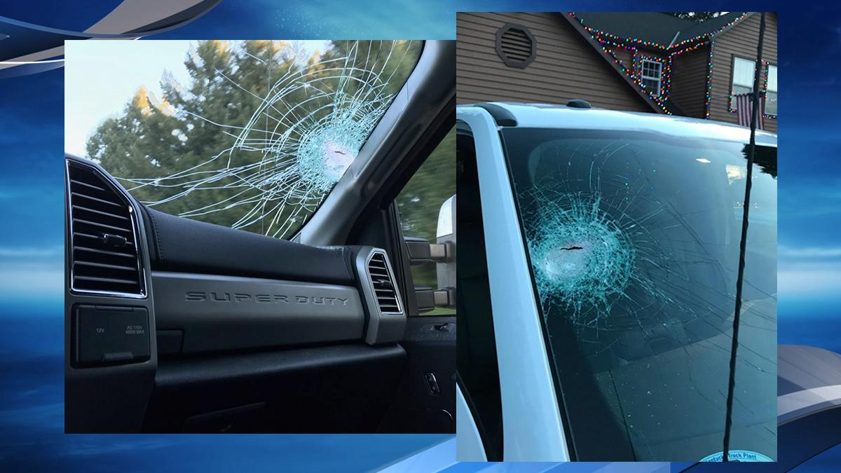 Photos of a vehicle damaged by someone tossing a rock at passing cars on Interstate 5 southbound exit to Interstate 205 - Oregon State Police photos