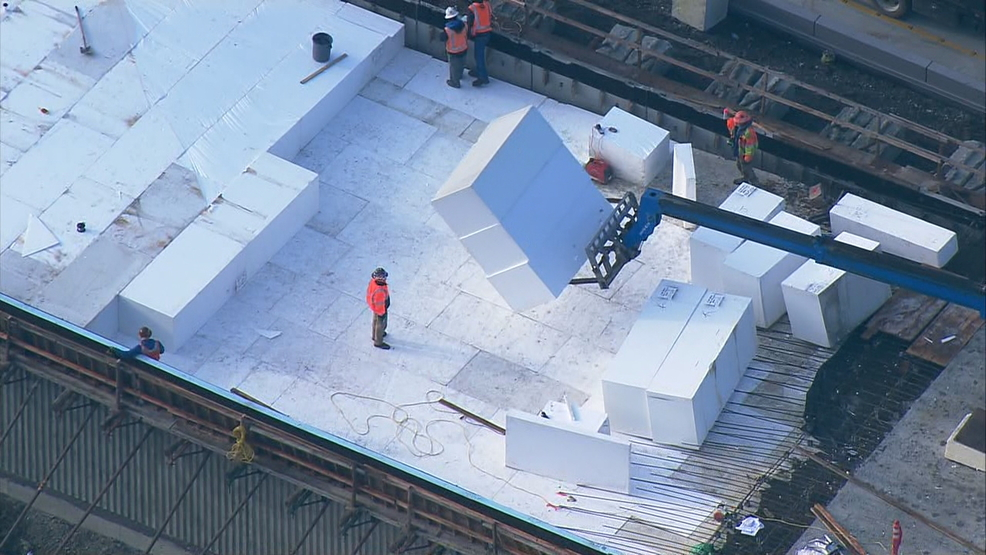 Watch SR 99 Construction Crews Use Large Blocks Of Foam To Build Ramps