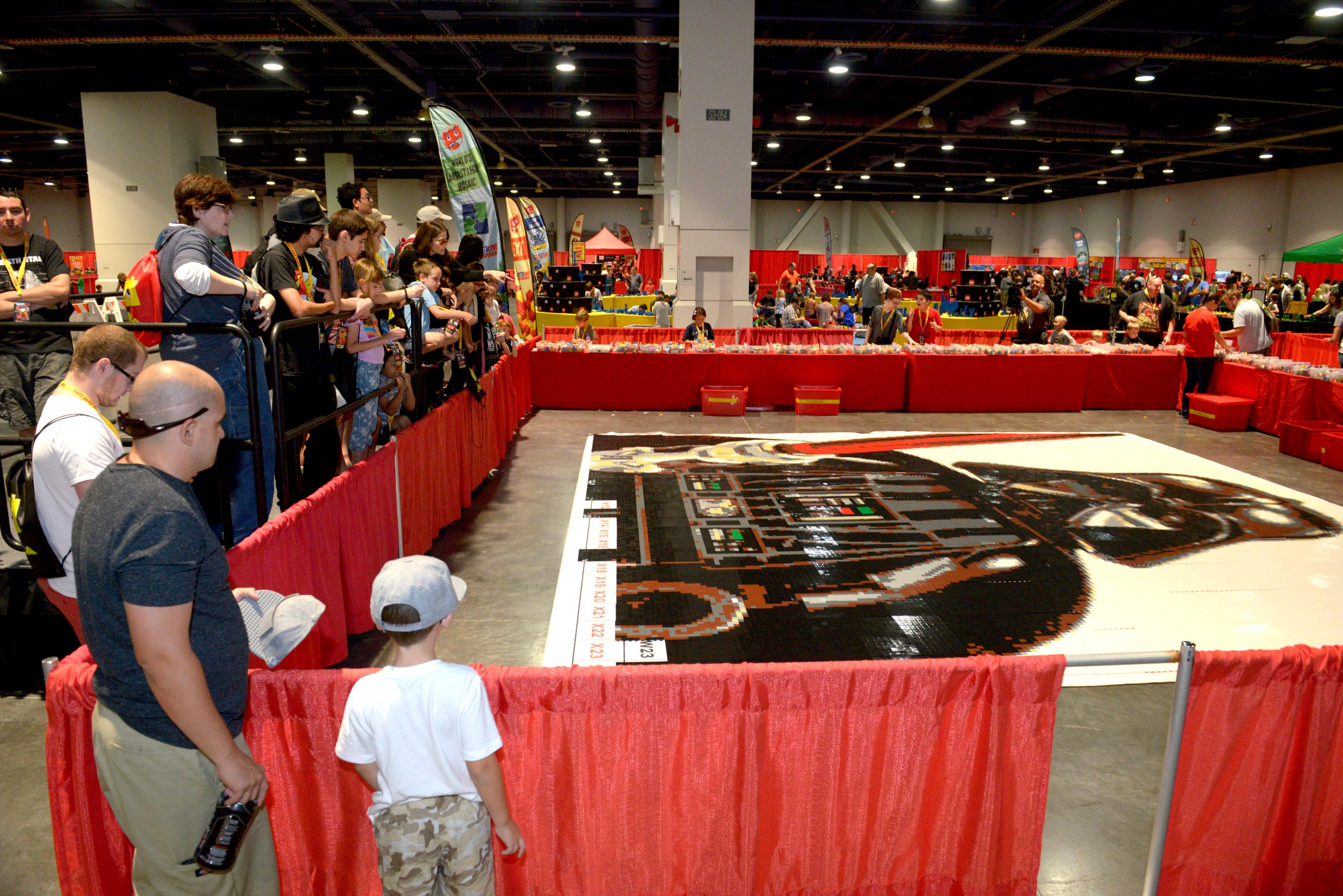 Fans watch as teams fit the last few pieces of the world's largest Lego mosaic together during the Brick Fest Live Lego Fan Experience at the Las Vegas Convention Center, September 9, 2017. [Glenn Pinkerton/Las Vegas News Bureau]