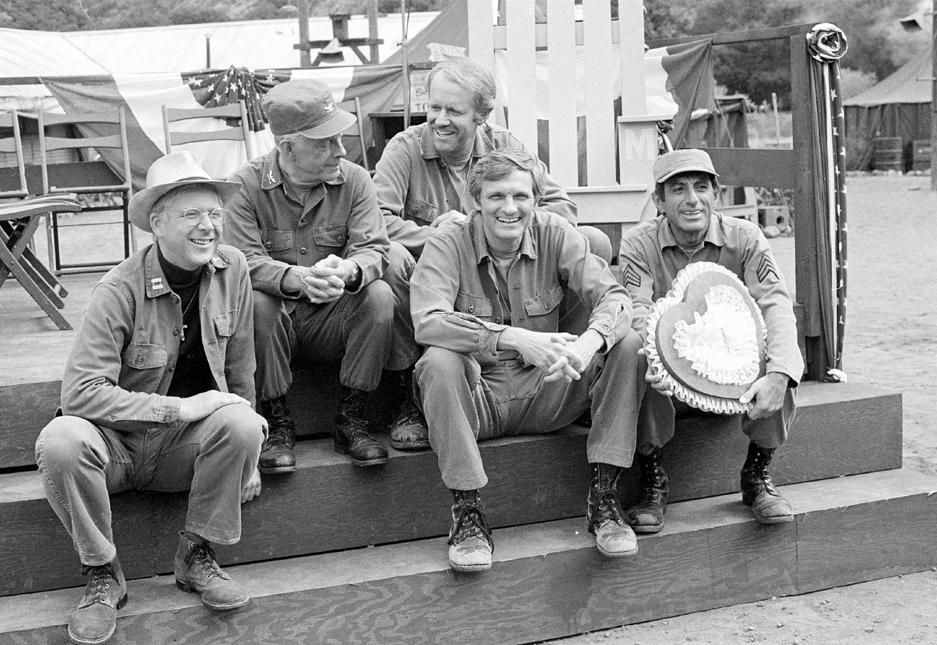 "FILE- In this Sept. 15, 1982, file photo, cast members of the television series ""M*A*S*H"" from left, William Christopher, Harry Morgan, Mike Farrell, Alan Alda, and Jamie Farr, take a break on the set during taping in Los Angeles. Christopher died Saturday, Dec. 31, 2016. He was 84. (AP Photo/Wally Fong, File)"