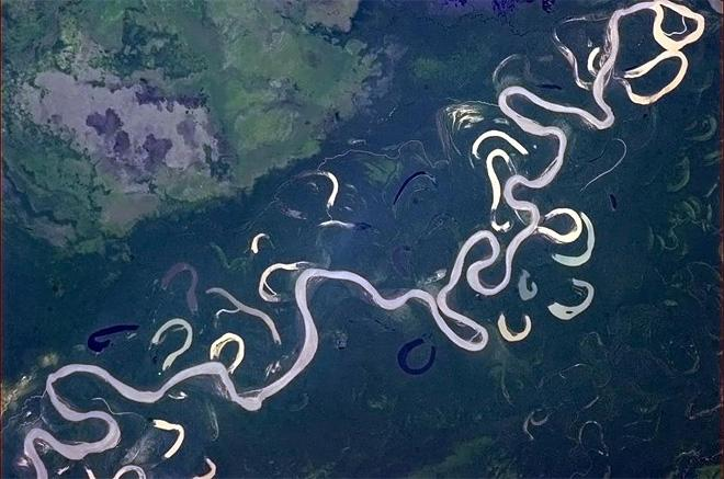 The sun glint turns this river to liquid silver (Photo & Caption: Chris Hadfield/NASA)