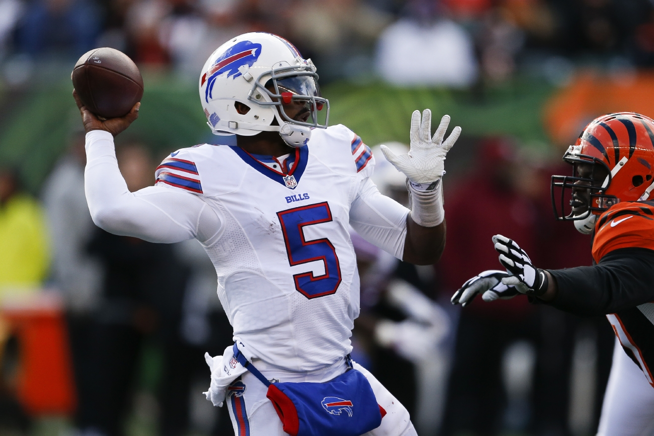 Buffalo Bills quarterback Tyrod Taylor (5) passes under pressure in the first half of an NFL football game against the Buffalo Bills, Sunday, Nov. 20, 2016, in Cincinnati. (AP Photo/Gary Landers)