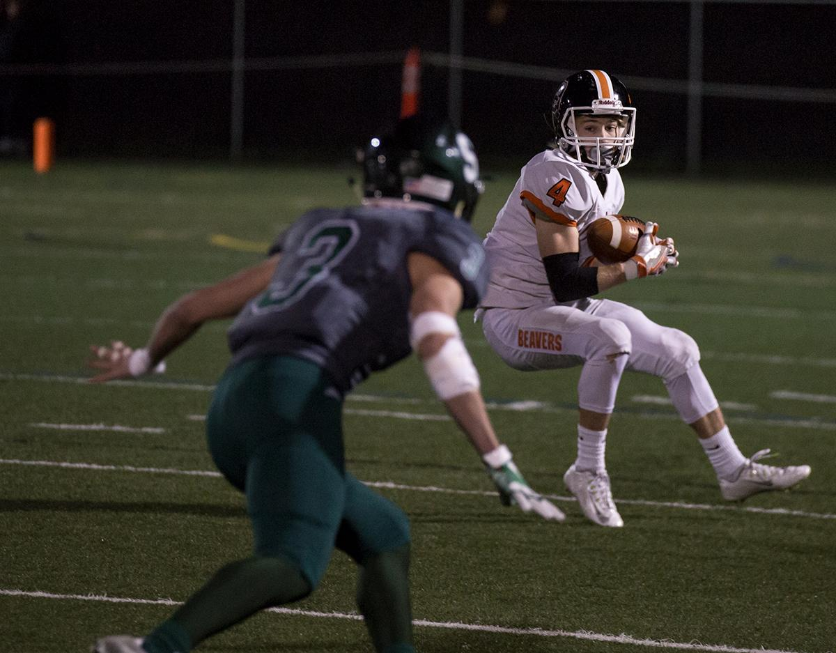 Beaverton's Grant Kirby (#4) keeps his eye on Sheldon's Wyatt Seidel (#3). The Sheldon Irish defeated the Beaverton Beavers 48 - 7 at Sheldon High School on Friday, November 3, to win the first round of the state playoffs. Photo by Kit MacAvoy, Oregon News Lab