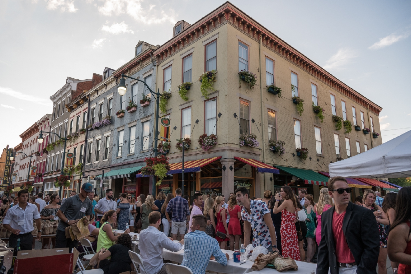"The Bacchanalian Society held its ""Summer Gathering"" event on Thursday, August 11 at Findlay market. Proceeds from the event went to benefit the Ohio Innocence Project. / Image: Phil Armstrong, Cincinnati Refined"