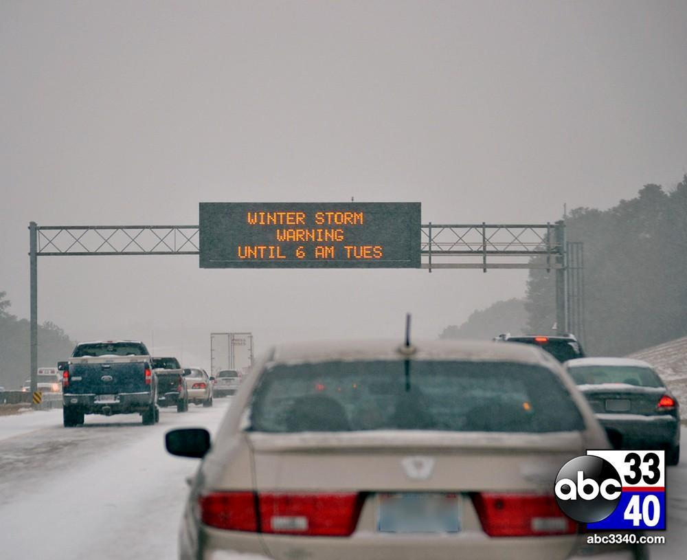 ALDOT sign informs motorists in Birmingham of a winter storm warning, Tuesday, January 28, 2014.