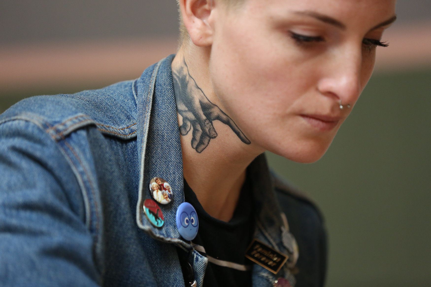 The buttons. The tattoos. The jacket. This details of this outfit are cooler than most of us could ever hope to be, while still being effortless. (Amanda Andrade-Rhoades/DC Refined)