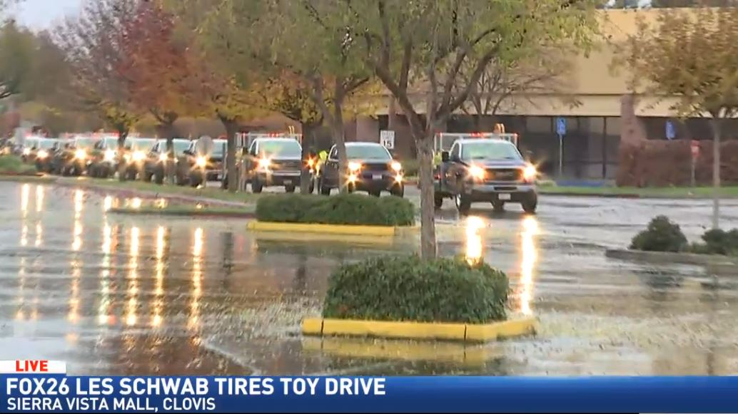 A convoy of 30 Les Schwab Tires trucks loaded with toys driving into Sierra Vista Mall