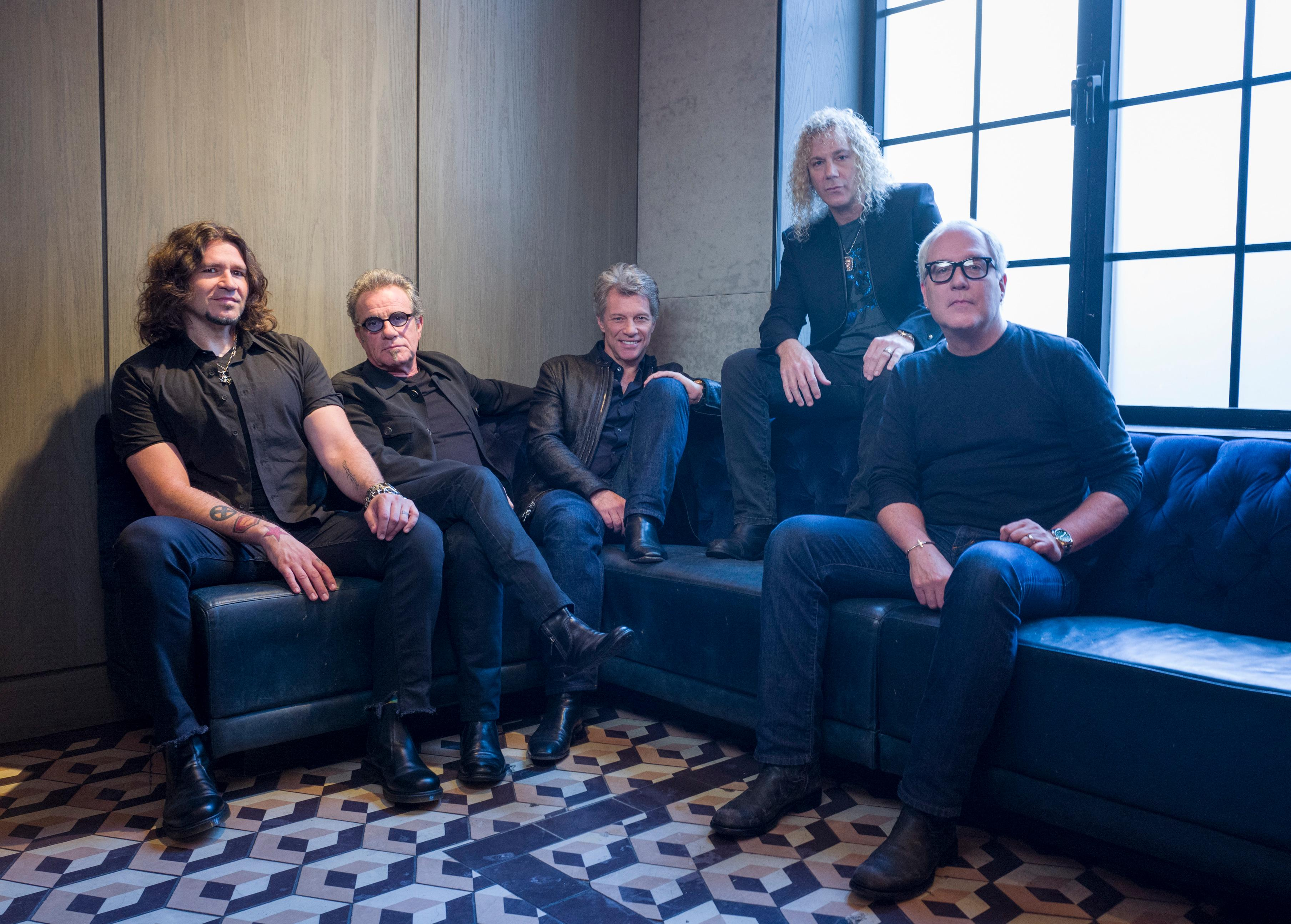 FILE - In this Oct. 19, 2016 file photo, members of Bon Jovi from left, Phil X, Tico Torres, Jon Bon Jovi, David Bryan and Hugh McDonald pose for a portrait in New York. The band will be inducted into the Rock and Roll Hall of Fame on April 14, 2018 in Cleveland, Ohio.                   (Photo by Drew Gurian/Invision/AP, File)
