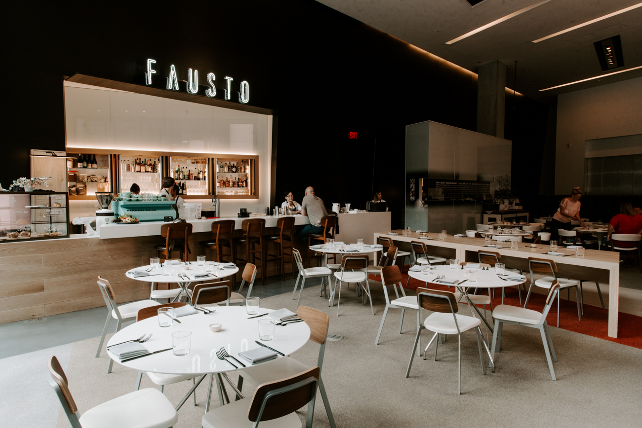 "As you walk into the Contemporary Arts Center at 6th and Walnut Street, you're greeted by Fausto, a corner cafe that serves ""California cuisine"" for breakfast, lunch, and dinner. Cincinnati natives Tony and Austin Ferrari, the duo behind Garfield Place's Ferrari Barbershop & Coffee Co., opened the cafe in the Contemporary Arts Center in during summer 2019. The menu is made with locally sourced and seasonal ingredients that change throughout the year. / Image: Brianna Long // Published: 9.8.19"
