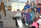 FOX 11's Michelle Melby speaks to Laura Farr's second grade class at Heritage Elementary School in De Pere Oct. 25, 2016, to kick off the Golden Apple Awards nomination process.