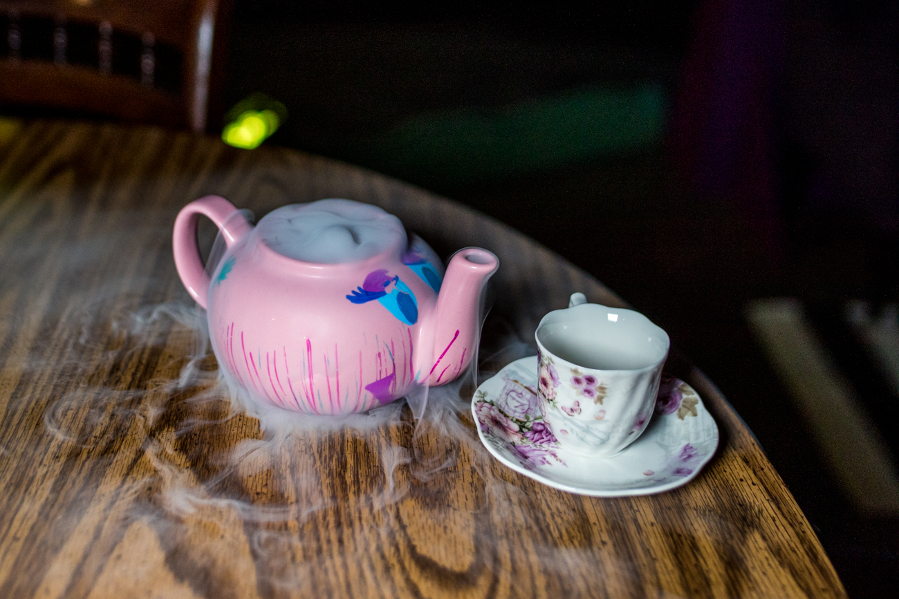 "The Alice, an immersive cocktail event themed after ""Alice in Wonderland,"" has made its way to Cincinnati. Located at The Banks, the pop-up features a 90-minute experience that has guests solving riddles and challenges in order to get ingredients to make ""Tea Pot"" cocktails, all within a whimsical, topsy-turvy setting. ADDRESS: 140 Marian Spencer Way (45202) / Image: Catherine Viox // Published: 1.22.21"