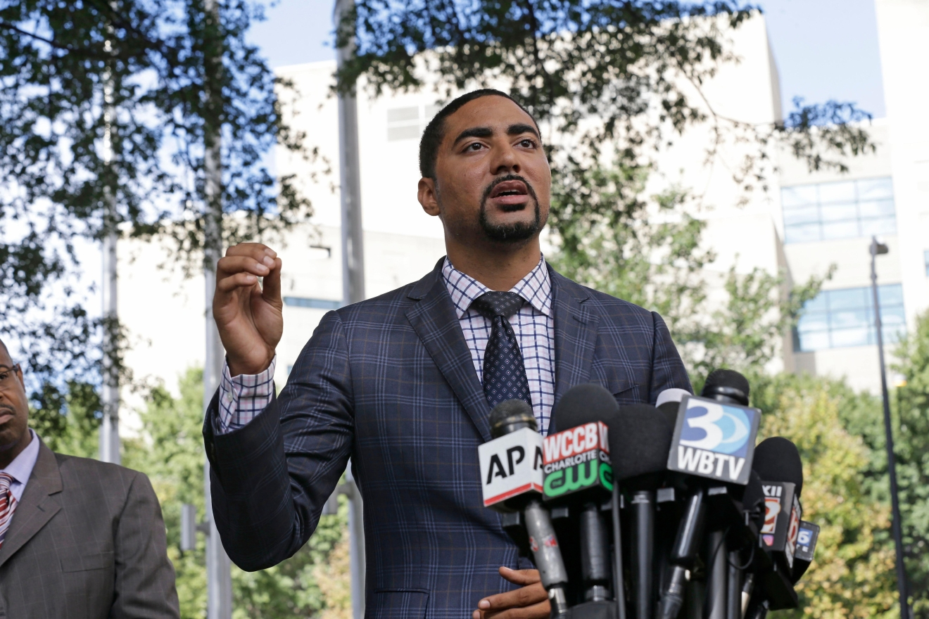 Attorney Justin Bamberg, representing the family of Keith Lamont Scott, addresses the media in Charlotte, N.C., Thursday, Sept. 22, 2016 following Tuesday's police shooting of Scott. (AP Photo/Gerry Broome)