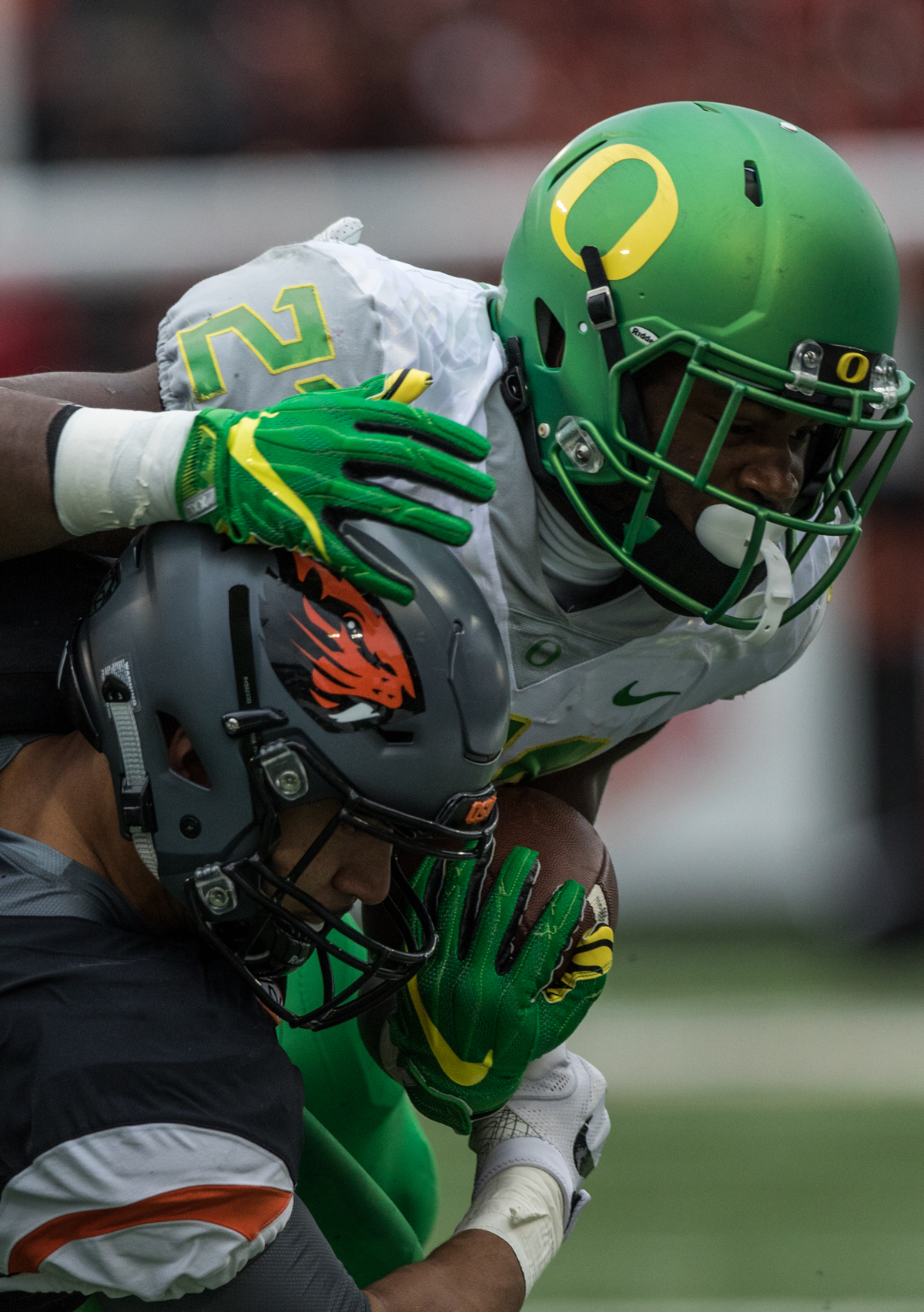 Oregon Ducks running back Royce Freeman (#21) attempts to shake off a tackle from Oregon State linebacker Titus Failauga (#93). The Oregon State University Beavers hosted the 120th Civil War against the University of Oregon Ducks on Saturday afternoon at Reser Stadium in Corvallis, Ore. The Oregon State Beavers beat the Oregon Ducks 34-24 breaking an eight-year losing streak. Photo by Austin Hicks, Oregon News Lab