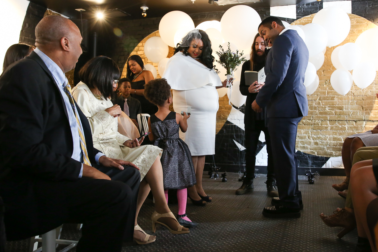 Millie Pinkney-Proctor, 4, served as the ring bearer.{ }(Amanda Andrade-Rhoades/DC Refined)