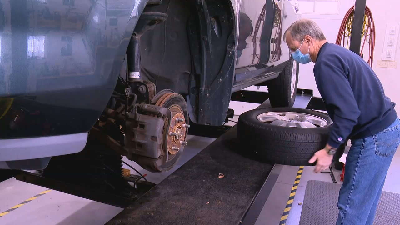 Chris Lewis repairs a car for the{ } Sharing House Wheels To Work Program in Transylvania County, North Carolina. (Photo credit: WLOS Staff)
