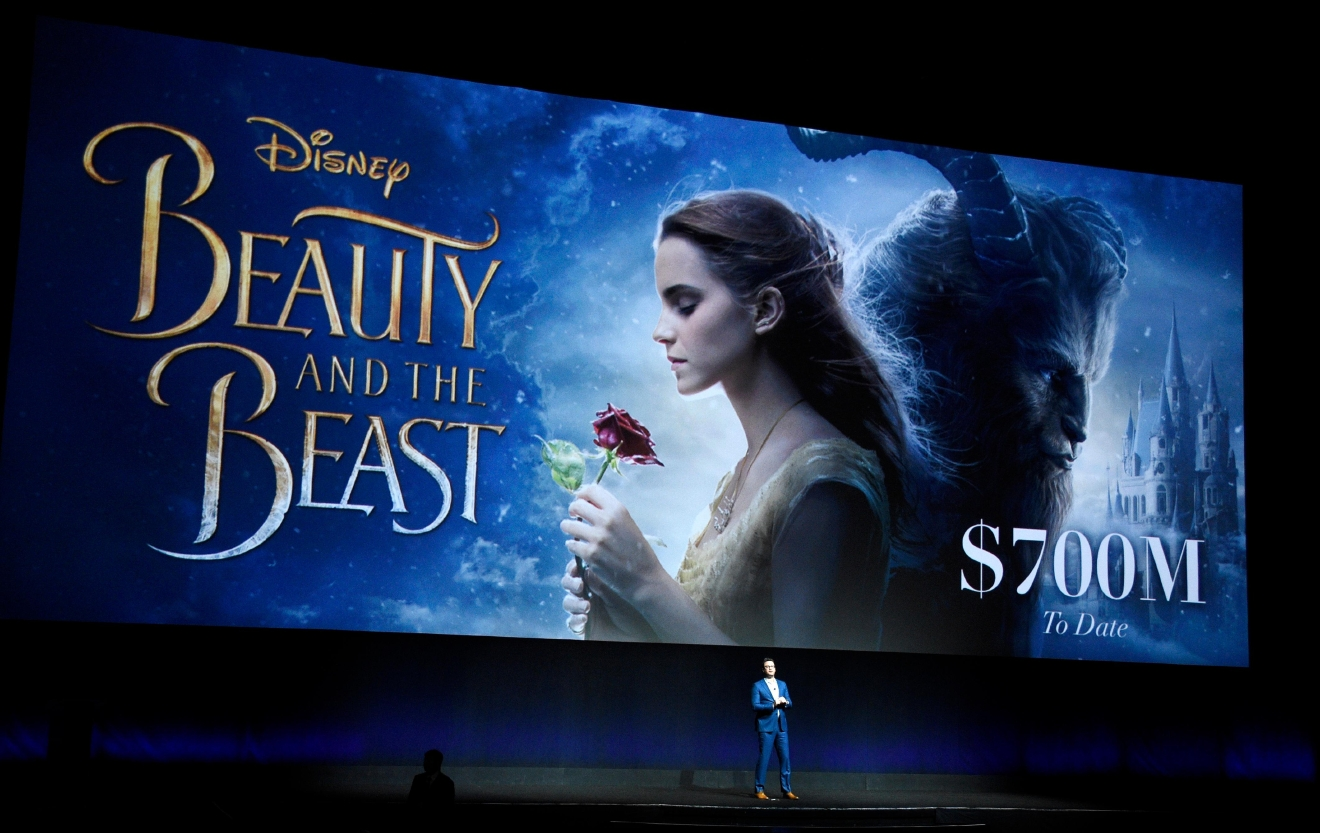 "Dave Hollis, executive vice president of theatrical exhibition sales and distribution for Walt Disney Studios, speaks about the box office performance of their film ""Beauty and the Beast"" during their presentation at CinemaCon 2017 at Caesars Palace on Tuesday, March 28, 2017, in Las Vegas. (Photo by Chris Pizzello/Invision/AP)"