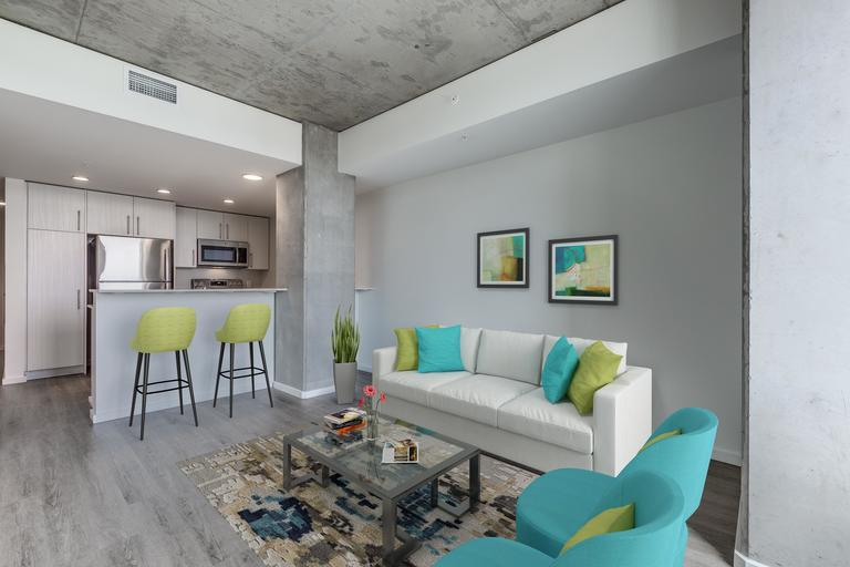 The Danforth homes showcase concrete ceilings and modern finishes creating a bright, sophisticated design aesthetic.
