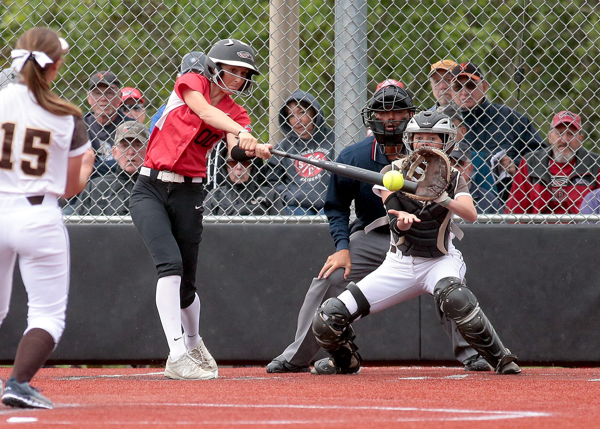 Southern Oregon University freshman Hannah Shimek unloads on the pitch from St. Francis RHP Morgan Dieringer at US Cellular Community Park on Wednesday.[PHOTO BY:  LARRY STAUTH JR]