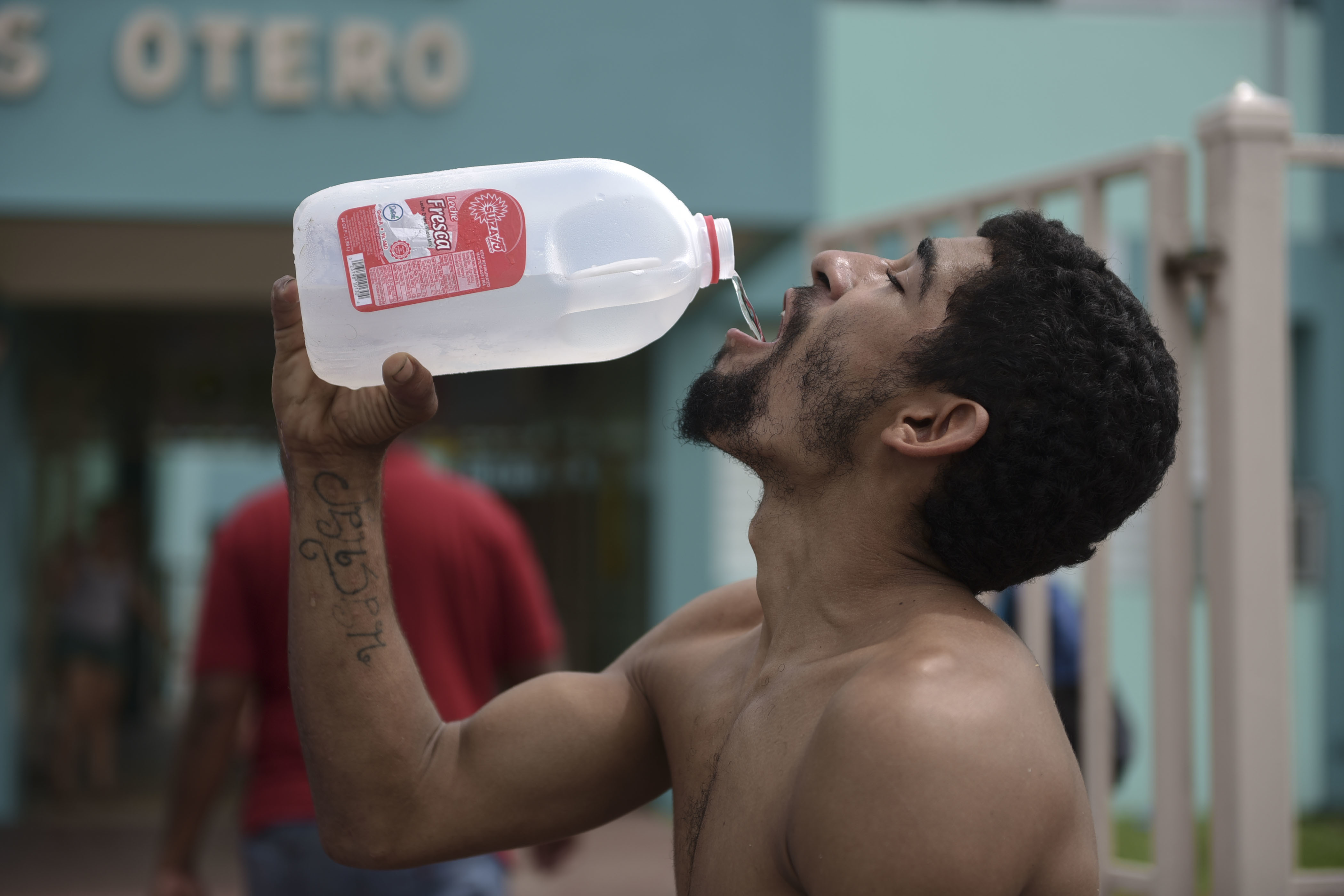 Julio Ortiz Montanez drinks water at the Jose Robles Otero Elementary School after the passing of Hurricane Maria, in Toa Baja, Puerto Rico, Friday, September 22, 2017. Because of the heavy rains brought by Maria, thousands of people were evacuated from Toa Baja after the municipal government opened the gates of the Rio La Plata Dam. (AP Photo/Carlos Giusti)