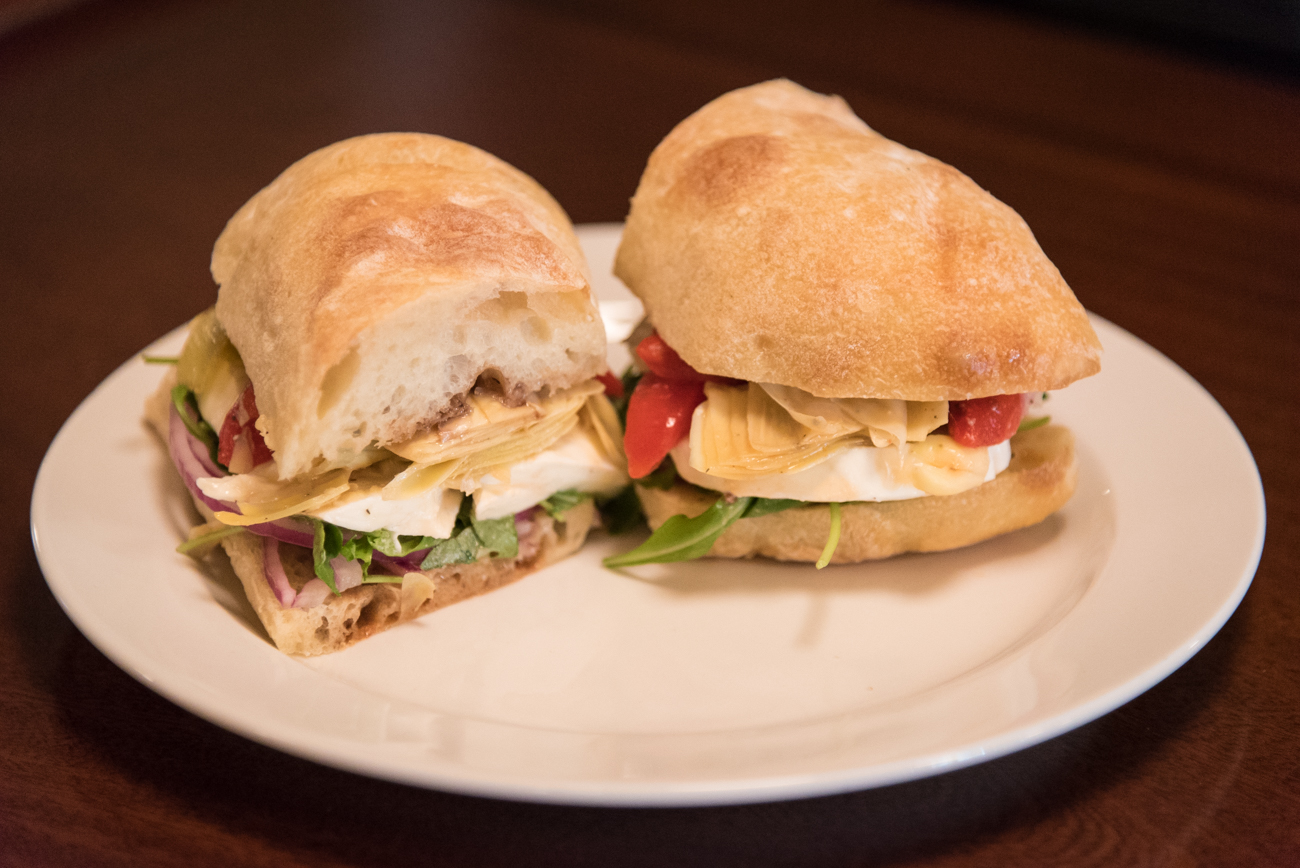 The Flapper: roasted red peppers, buffalo mozzarella, artichoke hearts, arugula, onions, and balsamic vinegar and oil on ciabatta / Image: Phil Armstrong, Cincinnati Refined // Published: 6.6.17