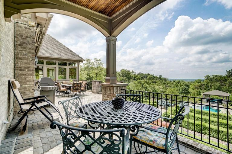 The expansive long terrace with inlayed paver stones is perfect for al fresco dining and entertaining guests. Sit back and take in the views! There's a natural gas hook up for grilling. / Image: Wow Video Tours // Published: 6.8.18