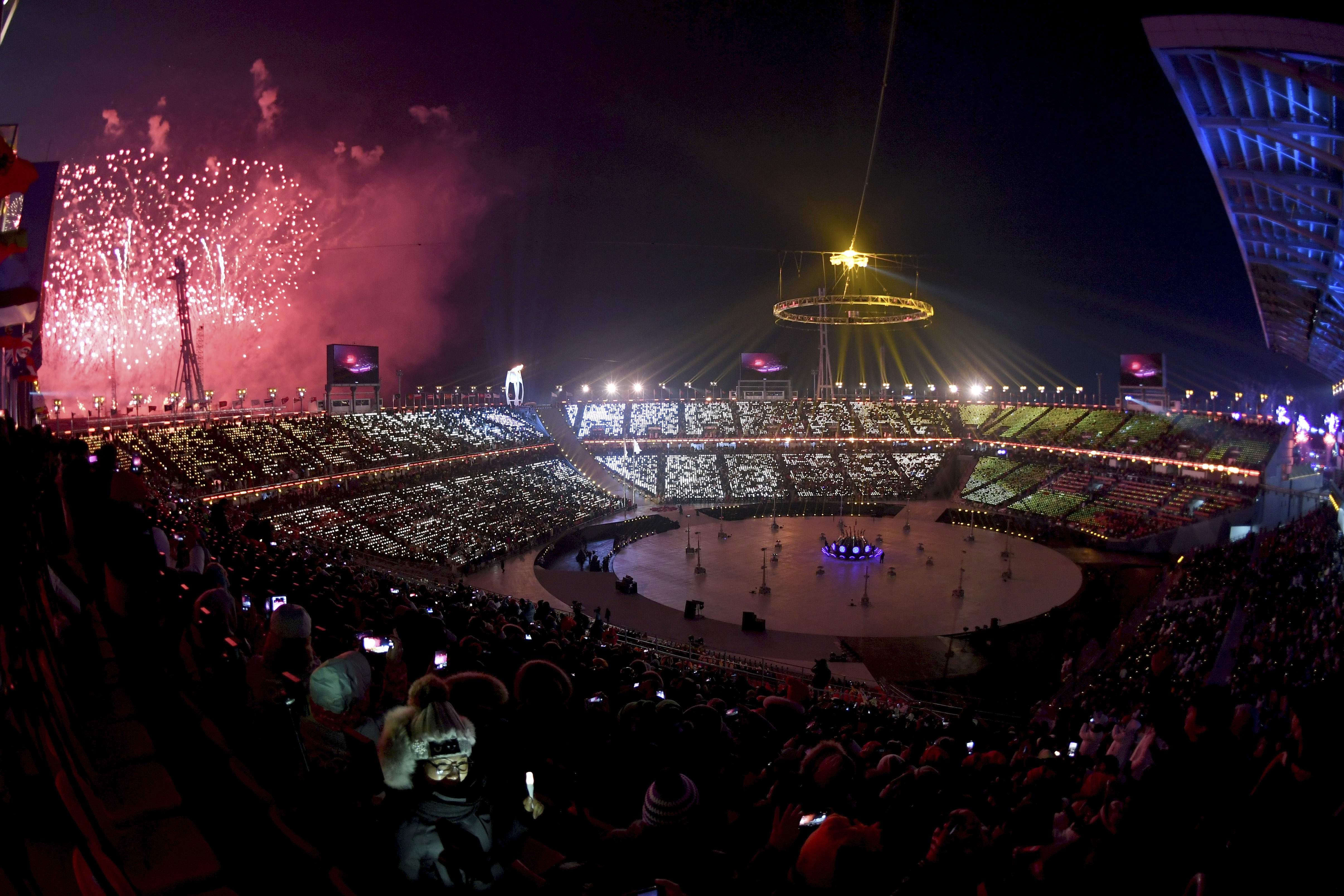 Fireworks go off after the Olympic flame was lit during the opening ceremony of the 2018 Winter Olympics in Pyeongchang, South Korea, Friday, Feb. 9, 2018. (Christof Stache/Pool Photo via AP)