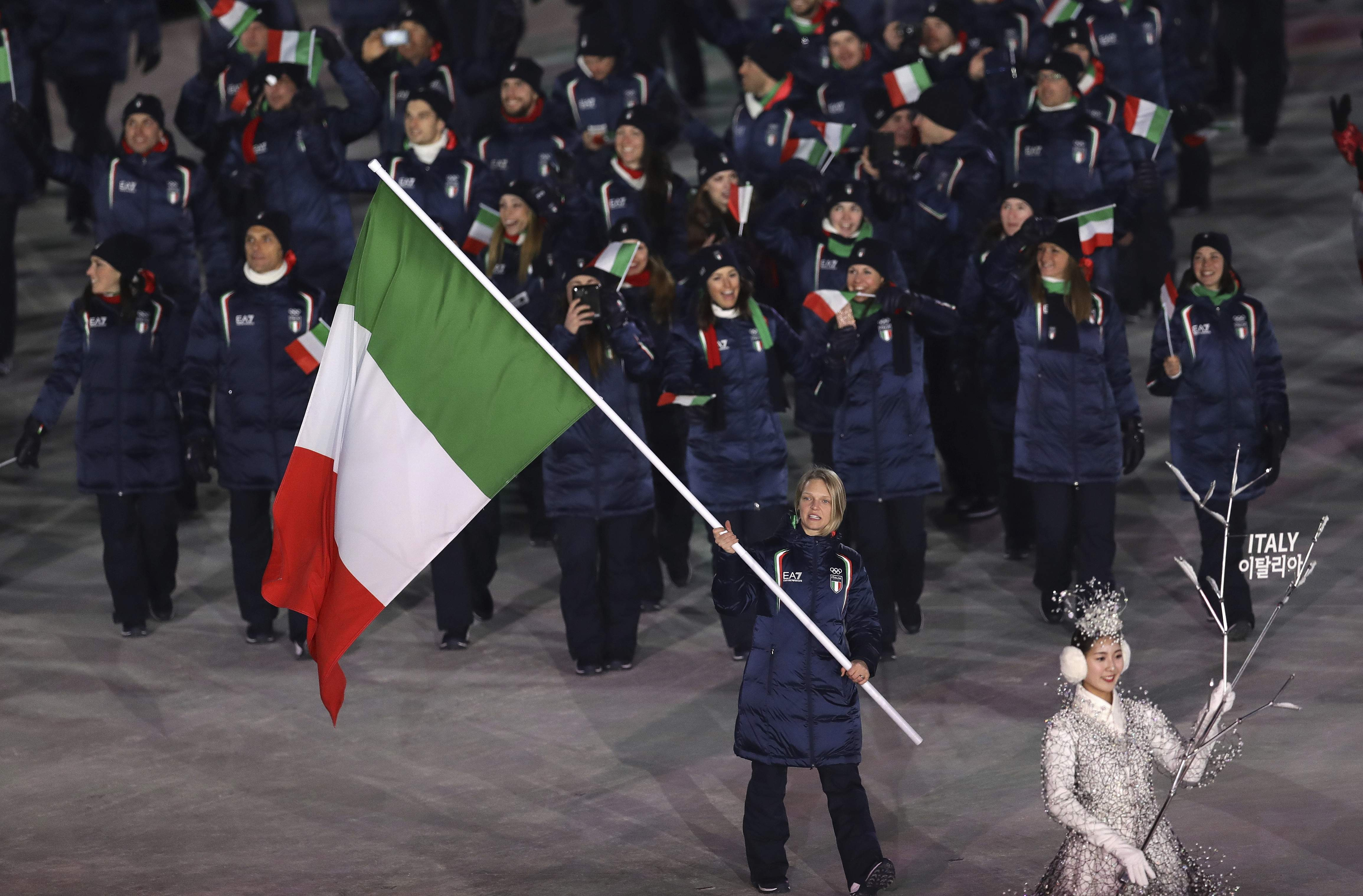 Arianna Fontana carries the flag of Italy during the opening ceremony of the 2018 Winter Olympics in Pyeongchang, South Korea, Friday, Feb. 9, 2018. (AP Photo/Michael Sohn)