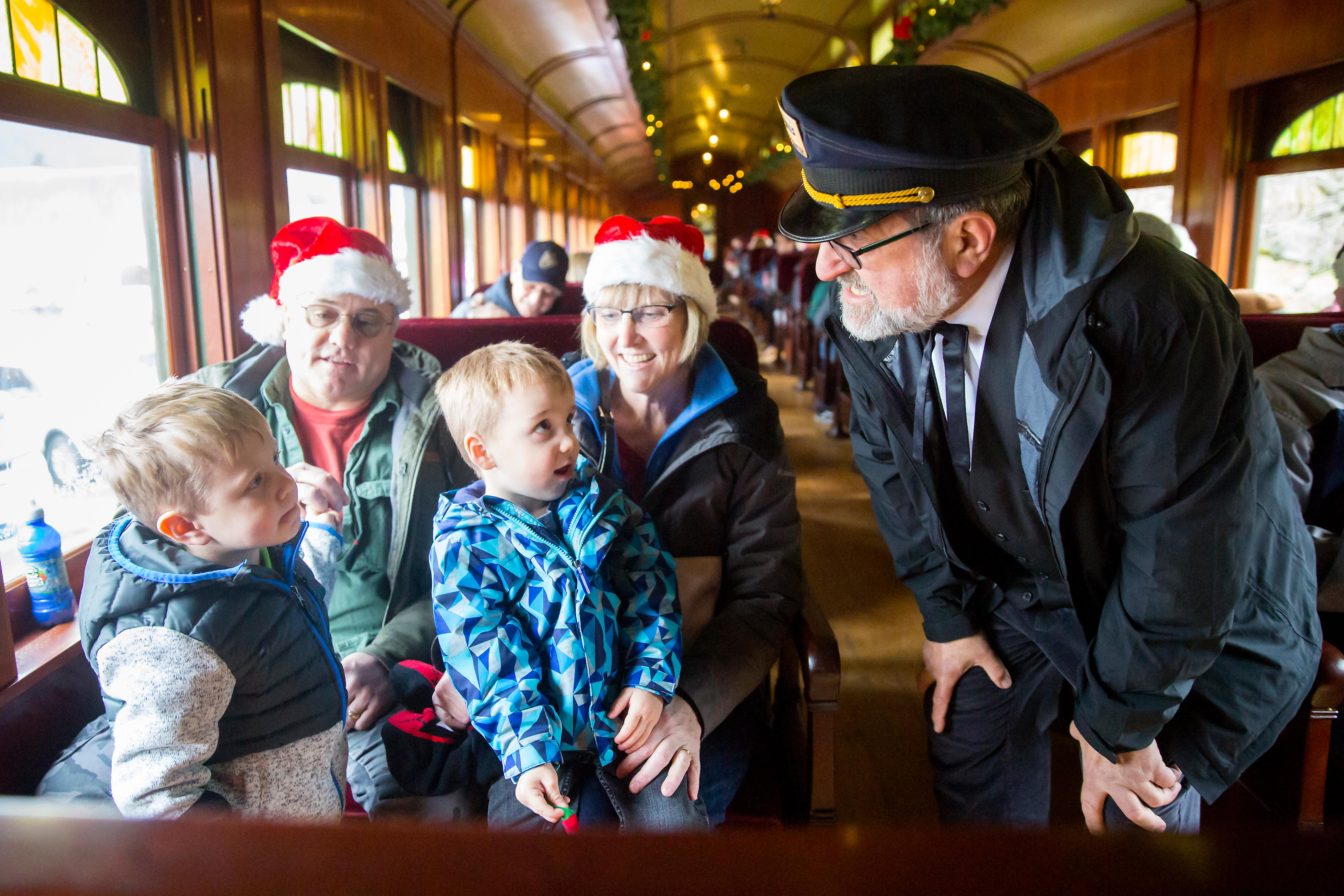 All aboard! Participants climb onto vintage railcars pulled by Locomotive 4012 during Santa Train - a four weekend holiday special put on by the Norhtwest Railway Museum. Guest board the train at the North Bend Depot and take a 3.5-mile journey to the Snoqualmie Depot where they are greet with sweet treats, hot drinks, and a gift from Santa Clause. The Snoqualmie Depot was orignially built in 1890. (Sy Bean / Seattle Refined)