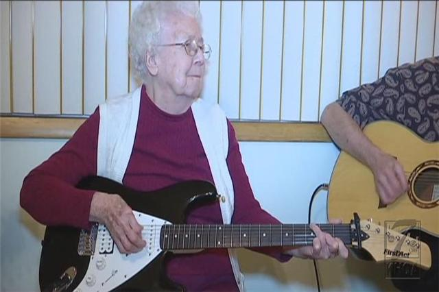 Lucille Gillespie, 94, plays the guitar at a Gillespie jam.