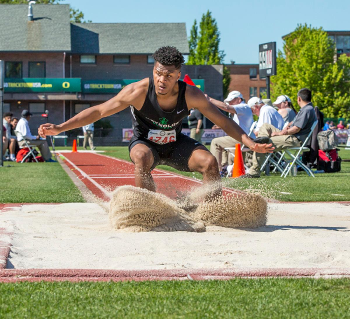 Long jumpers compete at the OSAA State Track Championships at Hayward Field on Saturday. Photo by James Wegter, Oregon News Lab