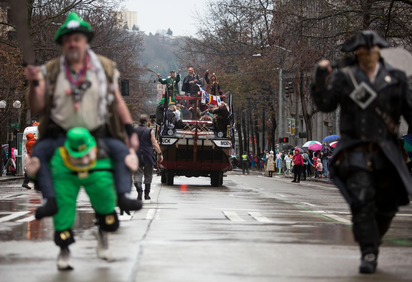 Rain didn't stop the crowds of people from coming out to the annual St. Patricks Day Parade in downtown Seattle. Bagpipers, bands, dancers, dogs and more marched down 4th to celebrate St. Patrick's Day. (Image: Sy Bean / Seattle Refined)