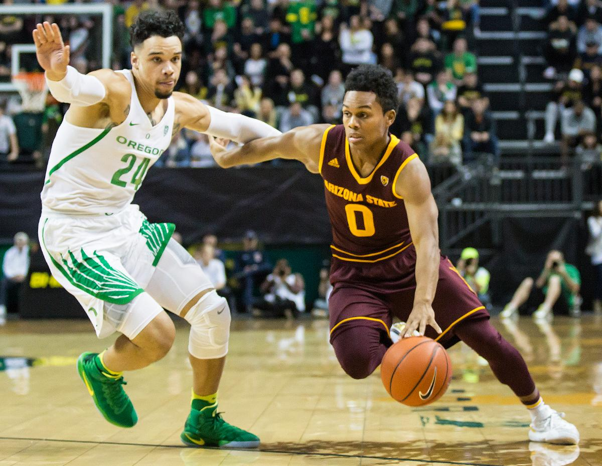 Arizona State guard Tra Holder (#1) pushed past Oregon forward Dillon Brooks (#24). Brooks had a team high 27 points. The Oregon Ducks defeated the Arizona State Sun Devils 71 to 70. Photo by Ben Lonergan, Oregon News Lab