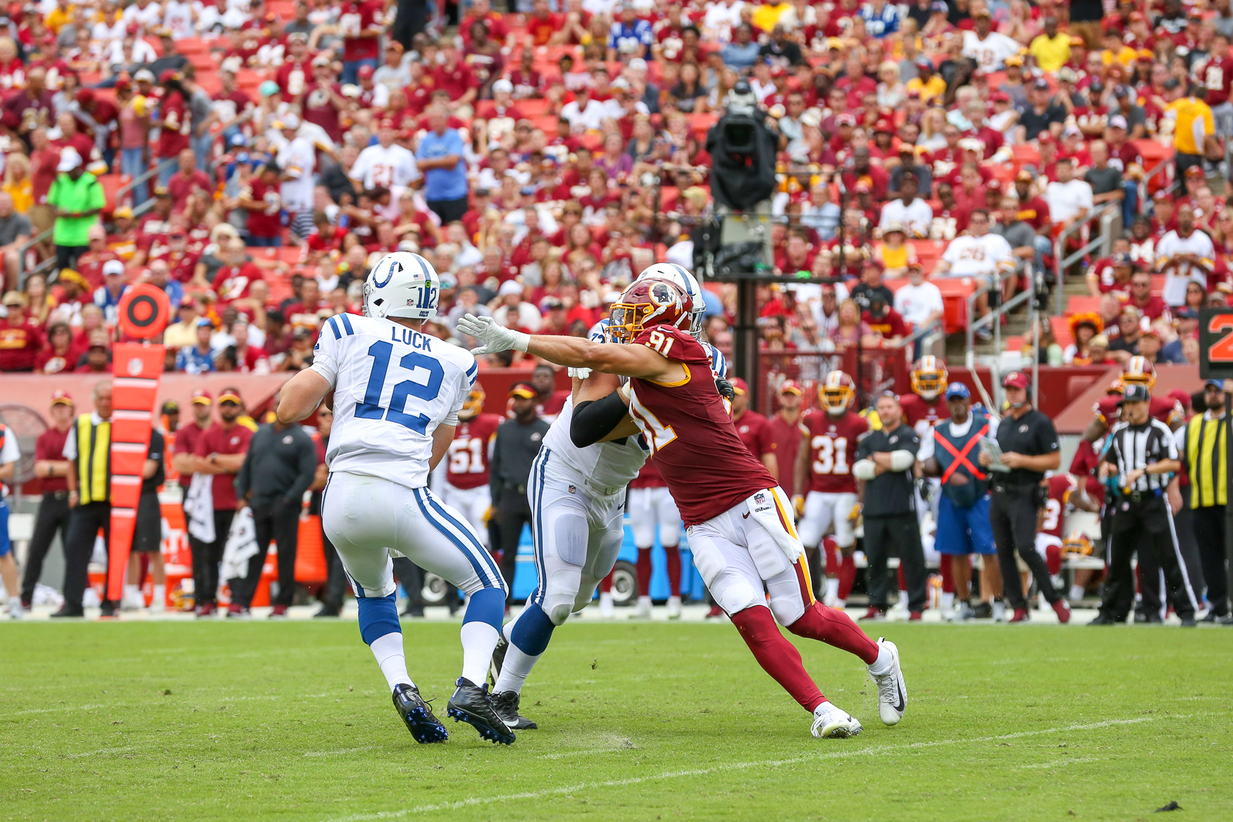 Football season is officially off to a rough start for fans of the Washington Redskins, who lost to the Indianapolis Colts during their home opener on September 16. The Redskins lost, 9 to 21. Although their offense was initially intense, they quickly crumbled and fans started abandoning the stadium by the start of the fourth quarter. The loss of the home opener may seem like a bad omen considering they also lost three out of their four pre-season games, but fans on both sides cheered during the halftime show, when local youth football teams hit the field. (Amanda Andrade-Rhoades/DC Refined)