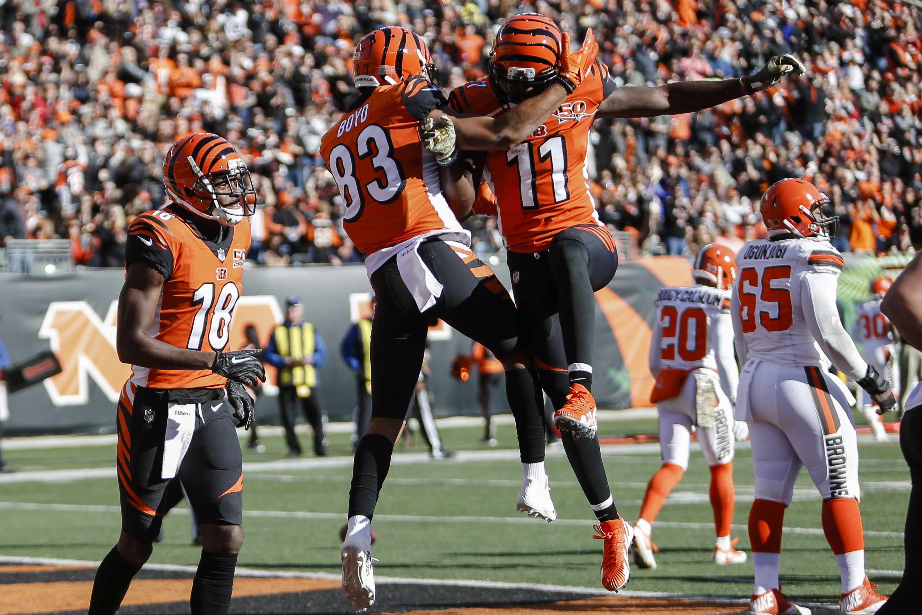 Cincinnati Bengals wide receiver Tyler Boyd (83) celebrates with wide receiver Brandon LaFell (11) after scoring a touchdown in the first half of an NFL football game against the Cleveland Browns, Sunday, Nov. 26, 2017, in Cincinnati. (AP Photo/Frank Victores)