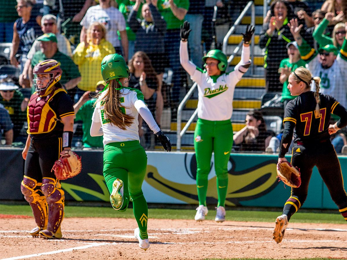The Duck's Haley Cruse (#26) runs into home base for the game winning point. The Oregon Ducks Softball team took their third win over the Arizona Sun Devils, 1-0, in the final game of the weekends series that saw the game go into an eighth inning before the Duck?s Mia Camuso (#7) scored a hit allowing teammate Haley Cruse (#26) to run into home plate for a point. The Ducks are now 33-0 this season and will next play a double header against Portland State on Tuesday, April 4 at Jane Sanders Stadium. Photo by August Frank, Oregon News Lab