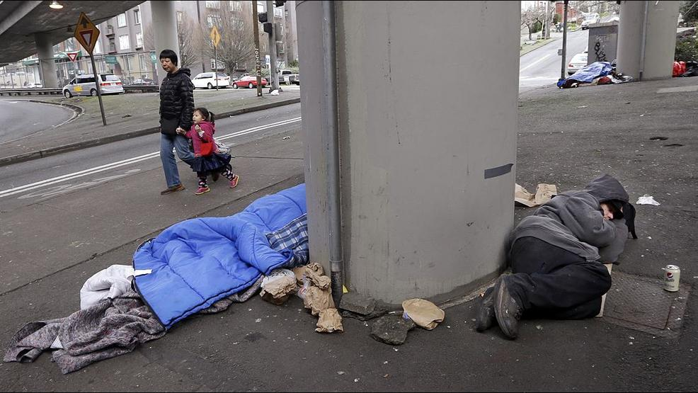 Seattle Homeless freeway overpass sleeping bag KOMO.jpg