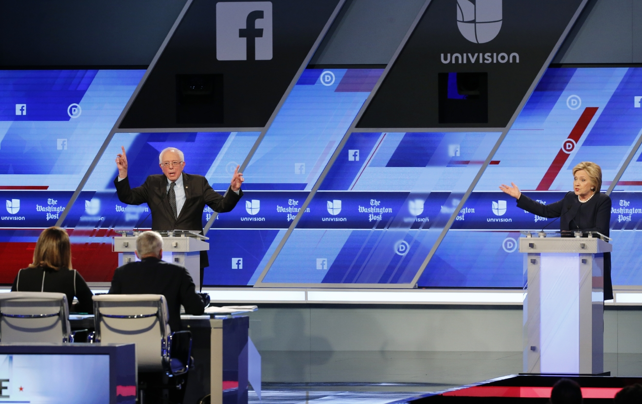 Democratic presidential candidate, Sen. Bernie Sanders, I-Vt and Democratic presidential candidate, Hillary Clinton  interrupt each other during the Univision, Washington Post Democratic presidential debate at Miami-Dade College,  Wednesday, March 9, 2016, in Miami. (AP Photo/Wilfredo Lee)