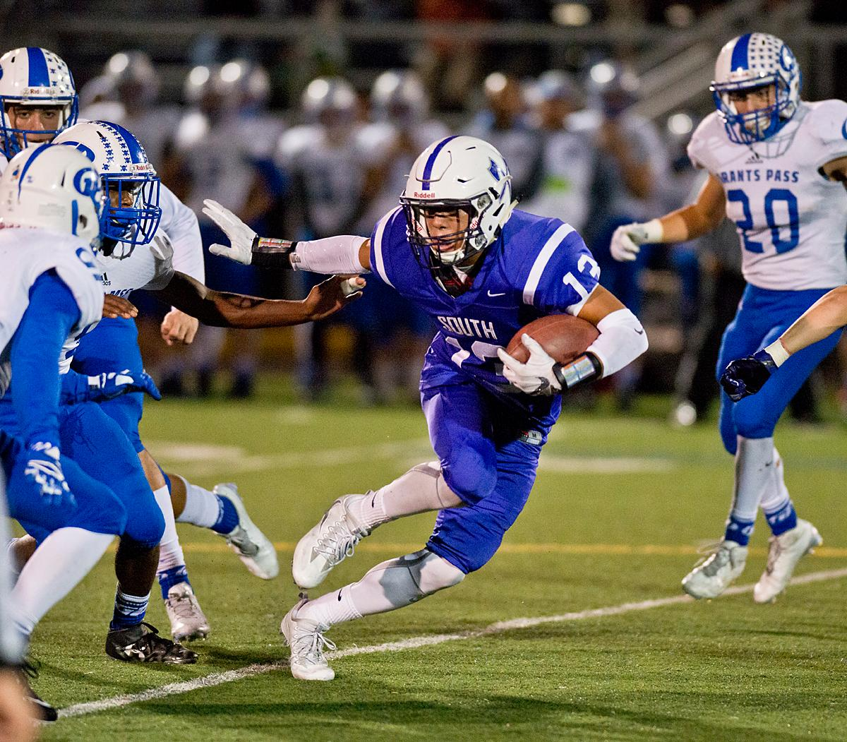 South Eugene Axemen wide receiver Myles Green-Richards (#13) attempts to evade the Grants Pass defense. Grants Pass defeated South 13-6 at South's homecoming game. Photo by Dan Morrison, Oregon News Lab