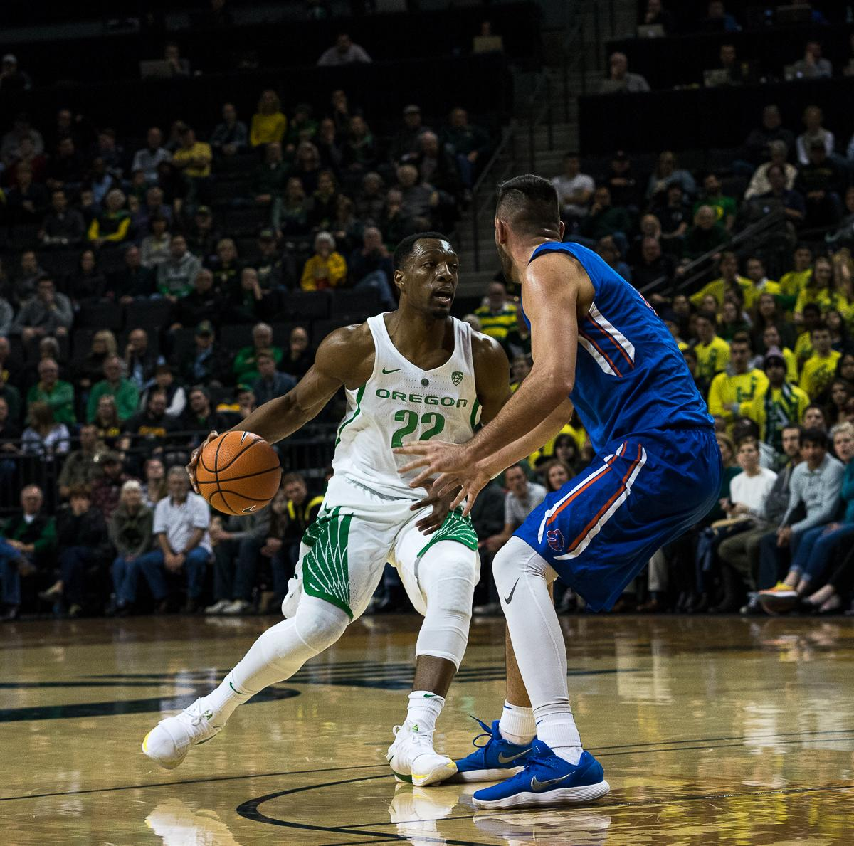 Oregon Duck MiKyle McIntosh (#22) tries to break past Boise State Bronco Zach Haney (#11). The Boise State Broncos defeated the Oregon Ducks 73 – 70 at Matthew Knight Arena in Eugene, Ore., on December 1, 2017. Photo by Kit MacAvoy, Oregon News Lab