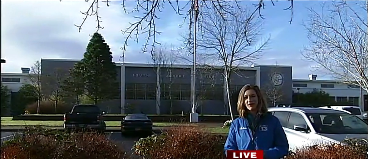 KVAL's Ellen Meny reporting live outside South Eugene High School, March 14, 2018. (SBG)