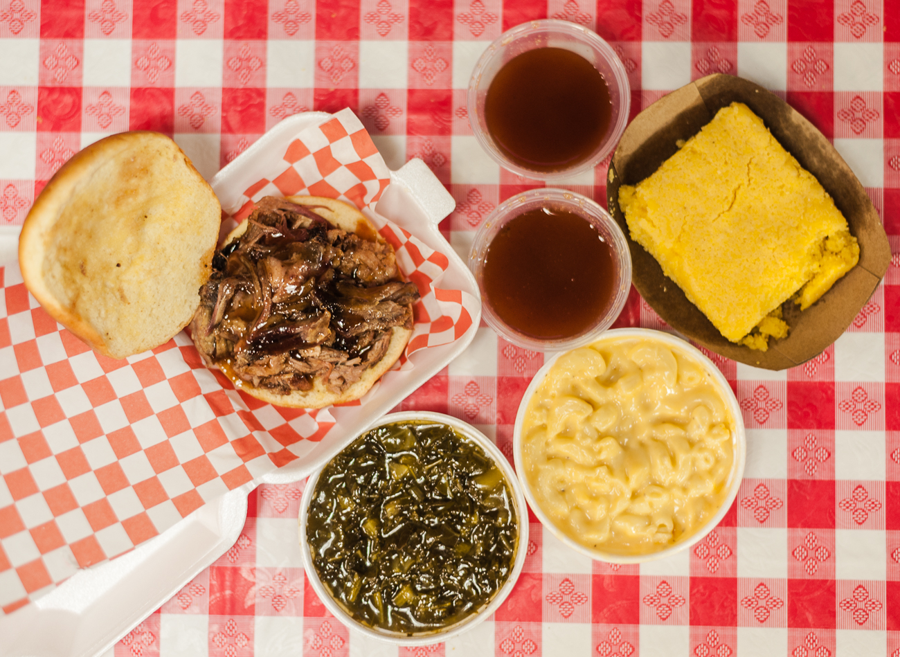 Collard greens, pulled pork sandwich, corn bread, mac & cheese, Goodies BBQ Sauce{ }/ Image: Kellie Coleman // Published: 6.19.20